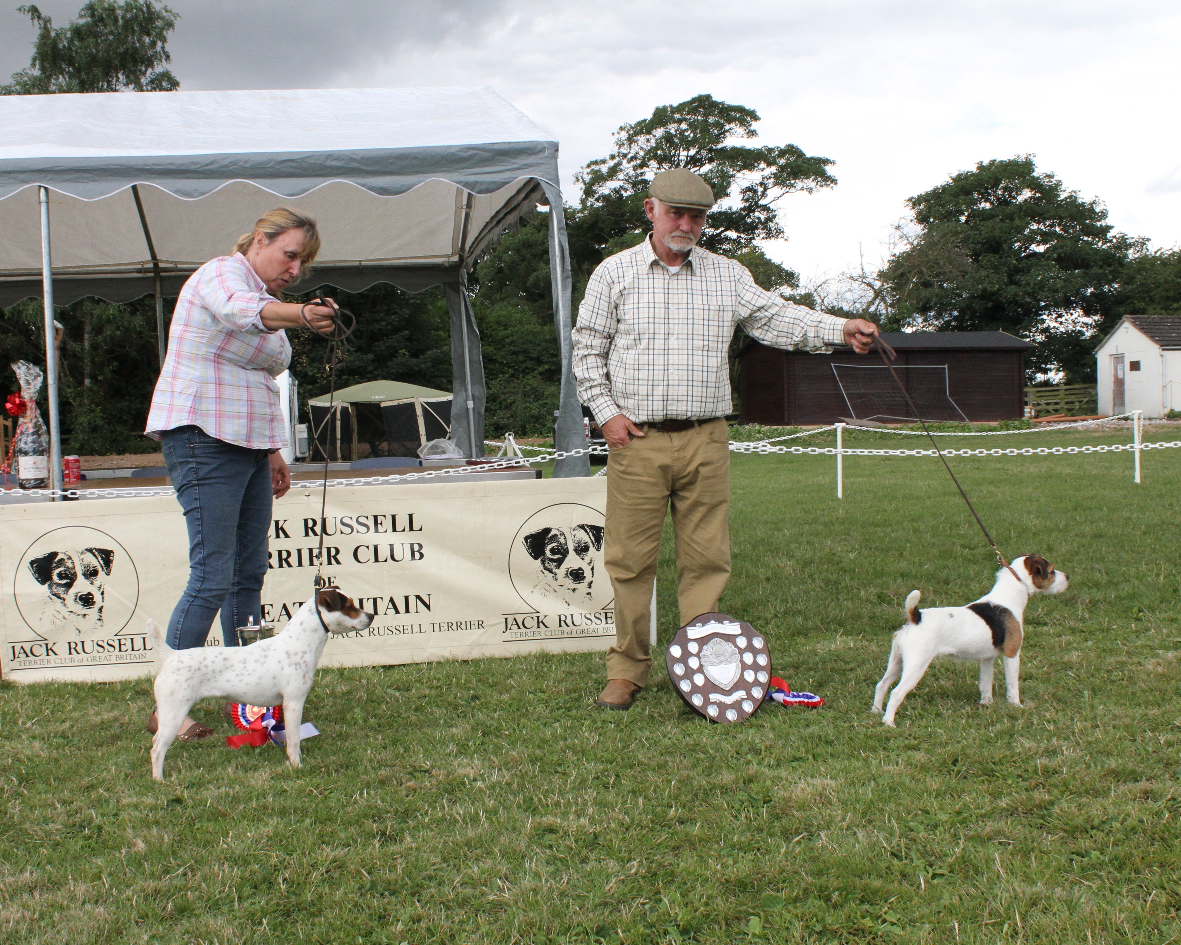 "Class 18. Best 10""-12.5"" Jack Russell Terrier. Champion Friarmoor Ellie of Rushill. Martyn & Liz Hulme. Reserve Champion Spinondaw Briar of Meynell-Sundance. Greg Mouseley & Anu Makela."