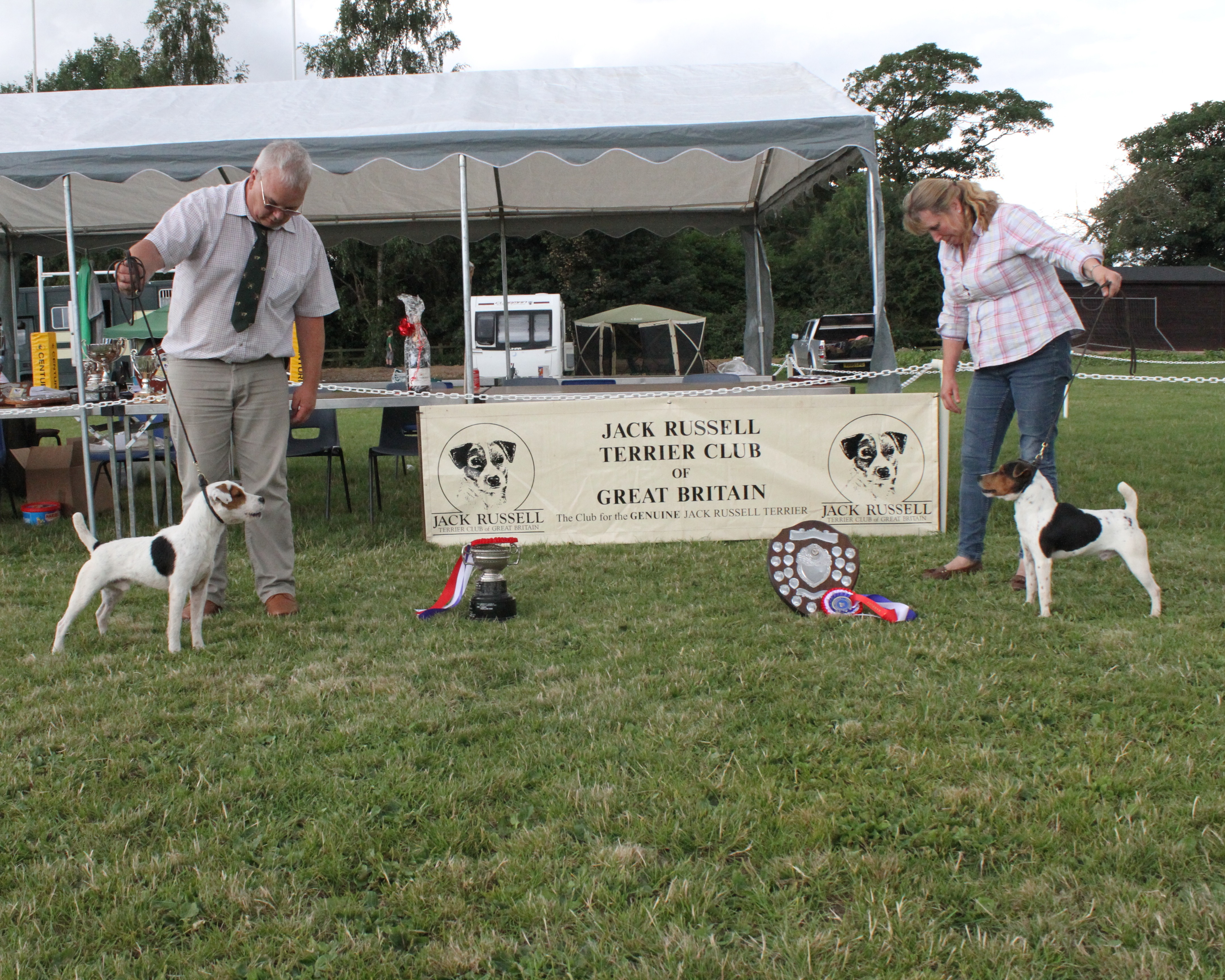 "Class 19. Best 12.5""-15"" Jack Russell Terrier. Champion Bob Scarfe of Rushill. Martyn & Liz Hulme. Reserve Champion Rushill Crankie. Martyn & Liz Hulme."